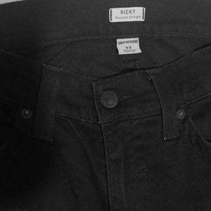 Black Ricky cut True Religion size 33. Never worn